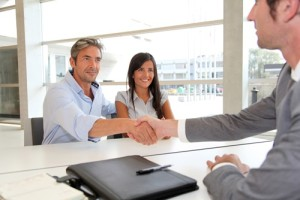 Couple reviewing loan guidelines and signing contract