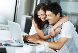 Couple Reviewing Loan Requirements Online